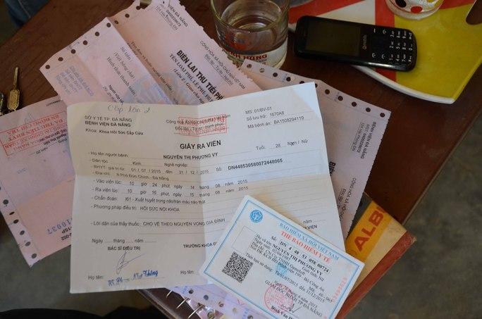 Giấy tờ ra viện cùng biên lai thu viện phí của bệnh nhân Vy