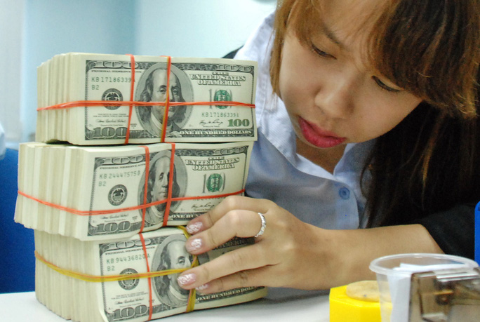 Giá USD tăng mạnh sau khi NH Nhà nước nới biên độ tỉ giá Ảnh: TẤN THẠNH