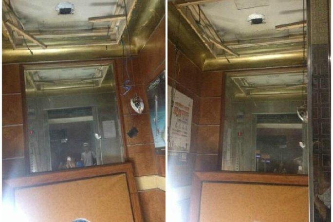 Chiếc thang máy rơi từ tầng 12. Ảnh: Straits Times