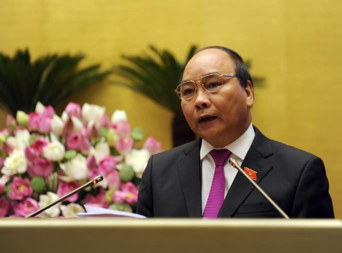 """Phó Thủ tướng Nguyễn Xuân Phúc thừa nhận còn nhiều cán bộ, công chức """"sáng cắp ô đi, chiều cắp ô về"""" Ảnh: Thắng Long"""