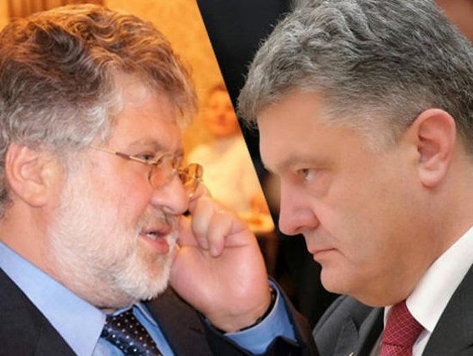 Tổng thống Petro Poroshenko (phải) và Thống đốc Igor Kolomoisky đang đối đầu gay gắt Ảnh: TVZVEZDA.RU