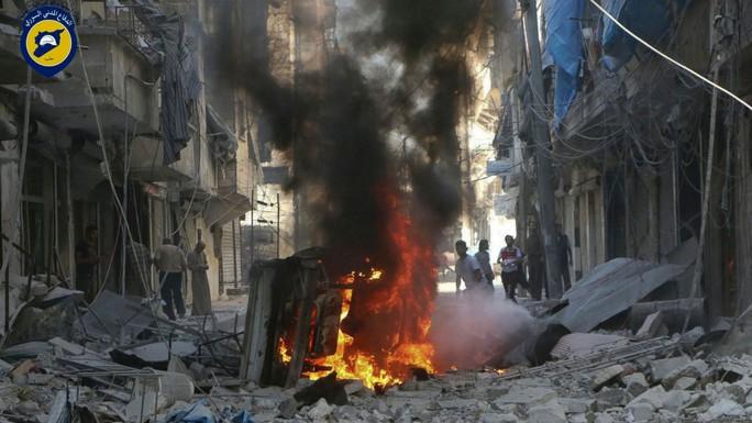 Vùng ngoại ô Mashhad của Aleppo trúng bom hôm 27-9. Ảnh: REUTERS