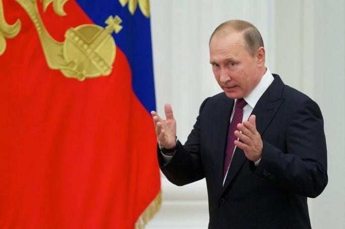 Tổng thống Putin đình chỉ hiệp ước hạt nhân với Mỹ. Ảnh: REUTERS
