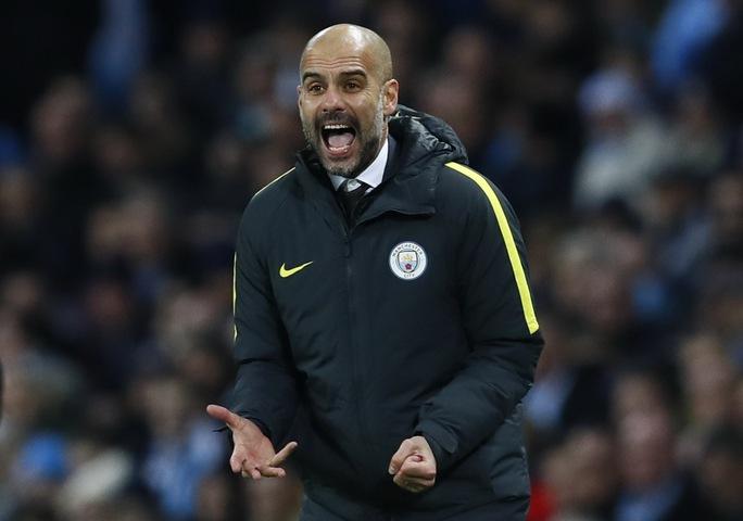 Guardiola vẫn chịu nhiều sức ép dù Man City vừa giải tỏa bớt áp lực sau chiến thắng 2-0 trước Watford Ảnh: REUTERS