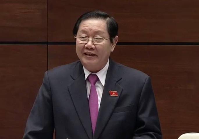 Bộ trưởng Bộ Nội vụ Lê Vĩnh Tân trả lời chất vấn của đại biểu QH chiều 16-11 - Ảnh chụp qua màn hình