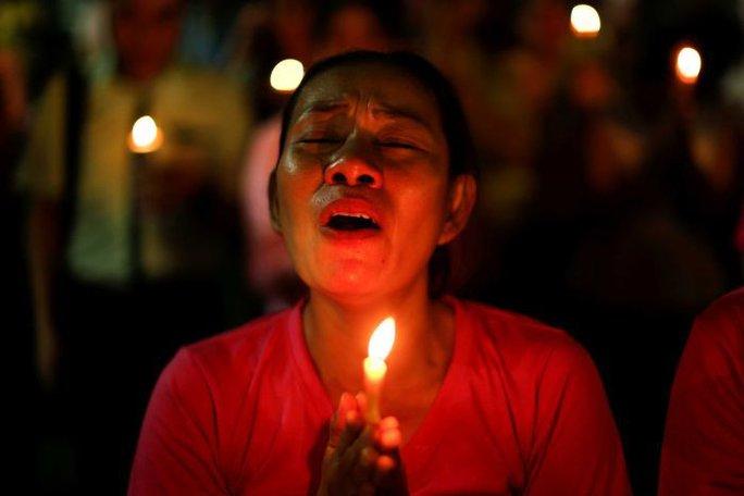 Người dân đau buồn khi hay tin quốc vương băng hà. Ảnh: Reuters