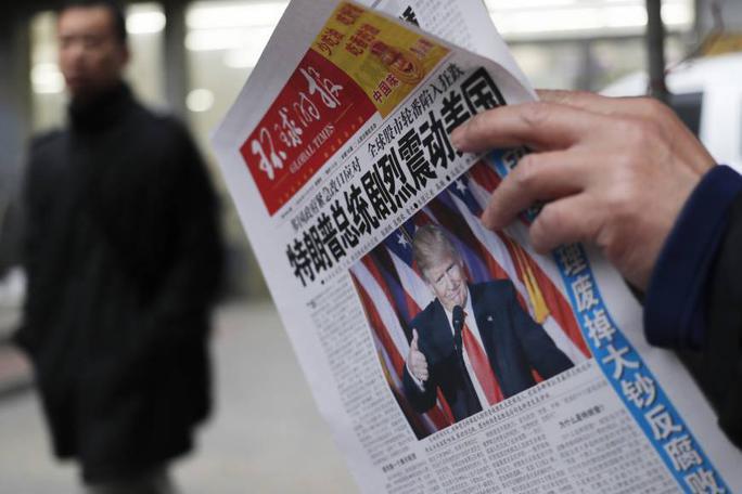Ông Trump xuất hiện trên trang bìa Thời báo Hoàn Cầu của Trung Quốc sau khi thắng cử Ảnh: AP