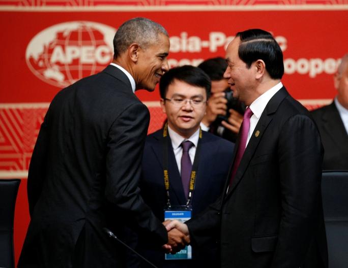 Chủ tịch nước Trần Đại Quang và Tổng thống Mỹ Barack Obama bắt tay tại Hội nghị Cấp cao APEC hôm 20-11 Ảnh: Reuters