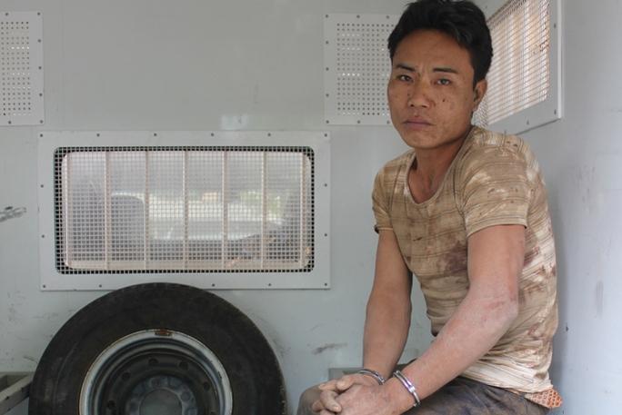 Nghi phạm Phù Minh Tuấn bị lực lượng chức năng bắt giữ Ảnh: Đoàn Tuấn