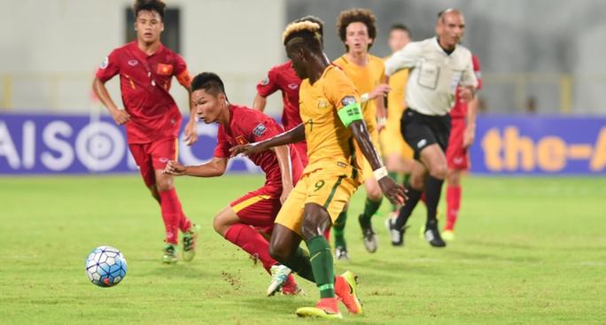 U16 Việt Nam của Duy Khiêm (trái) được ngợi khen khi thể hiện tinh thần thi đấu kiên cường trong trận thắng Úc Ảnh: AFC