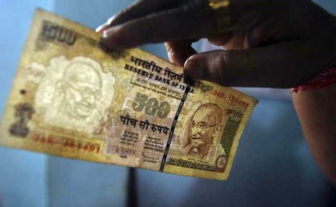 Tờ 500 và 1.000 rupee cũ sẽ không còn giá trị kể từ ngày 9-11. Ảnh: NDTV