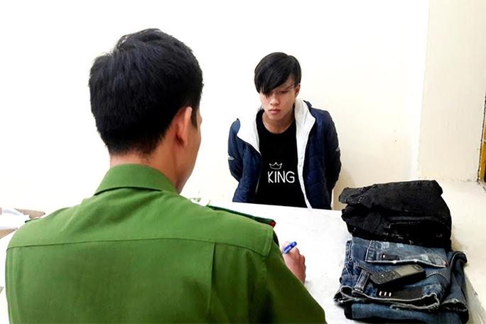 Nguyễn Quang Dũng tại cơ quan điều tra.