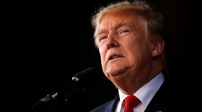 Ông Trump nói rằng nước Mỹ cần bước qua và hòa giải. Ảnh: Reuters