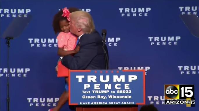 Bé gái quay mặt từ chối nụ hôn của ông Trump. Ảnh: ABC 15