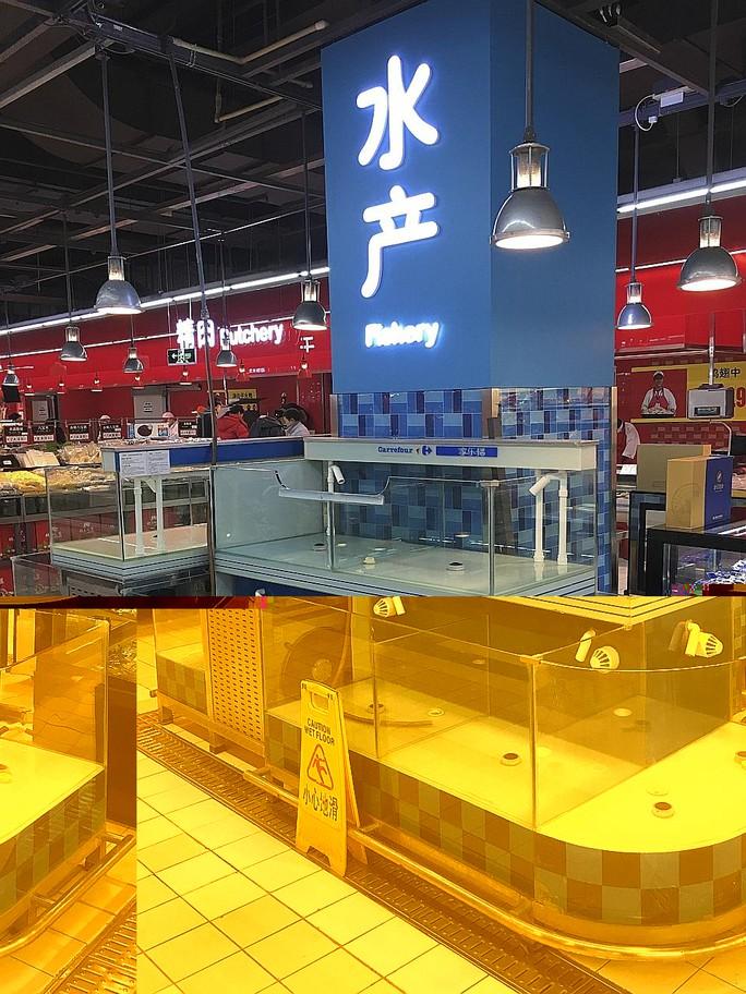 Những hồ cá trống trơn tại siêu thị Carrefour ở thủ đô Bắc Kinh hôm 24-11. Ảnh: New York Times