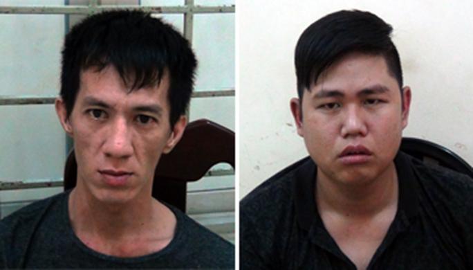 Trịnh Tấn Huy (bên trái) và Vũ Ngọc Cường tại cơ quan công an.