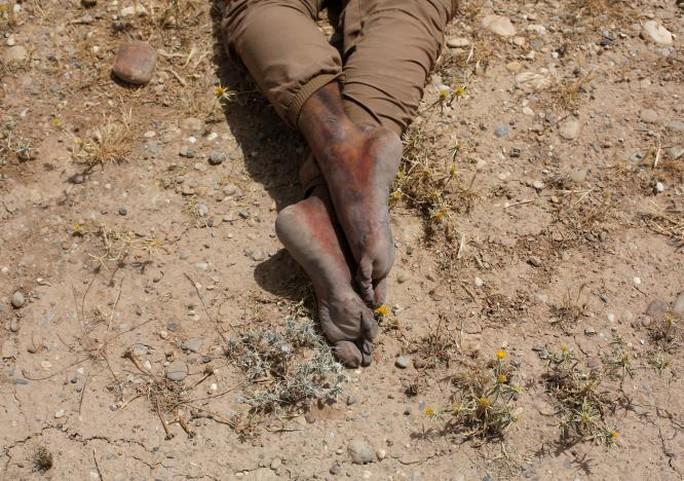 Iraq: Bị giết, vứt xác lộ thiên vì gia nhập IS? - Ảnh 2.