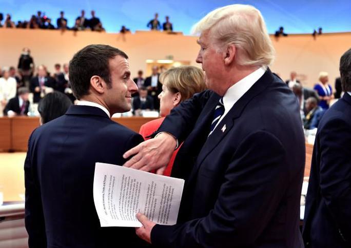 Đằng sau tình huynh đệ Trump - Macron - Ảnh 2.