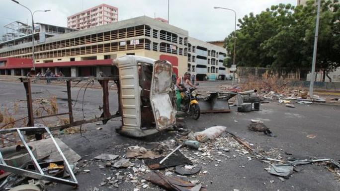Venezuela: Đụng độ tại đình công triệu người, 3 người chết - Ảnh 5.