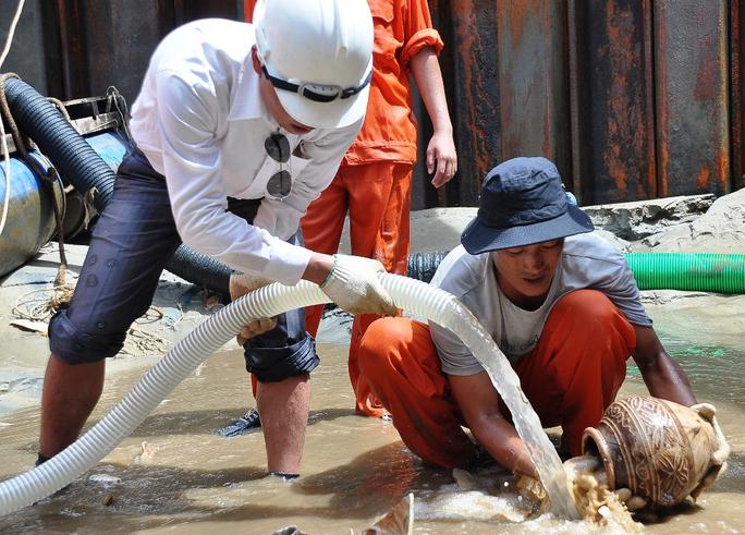 Khẩn cấp khai quật tàu cổ ở Quảng Ngãi - Ảnh 1.