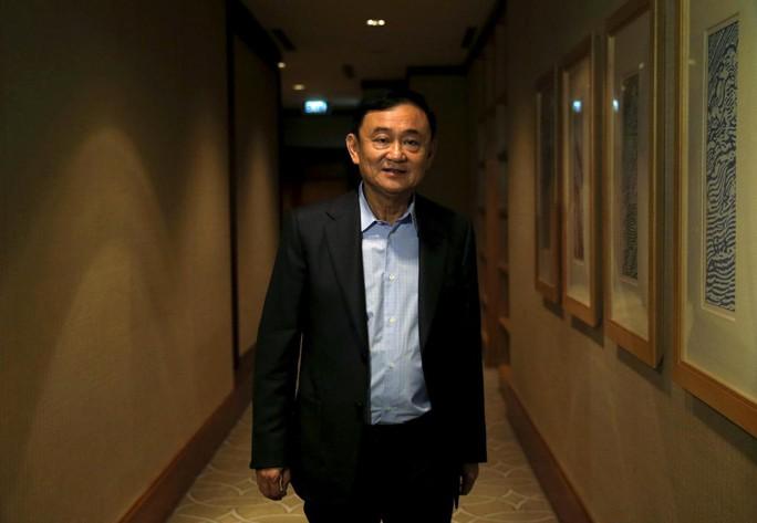 Thêm tội khi quân chờ ông Thaksin - Ảnh 1.