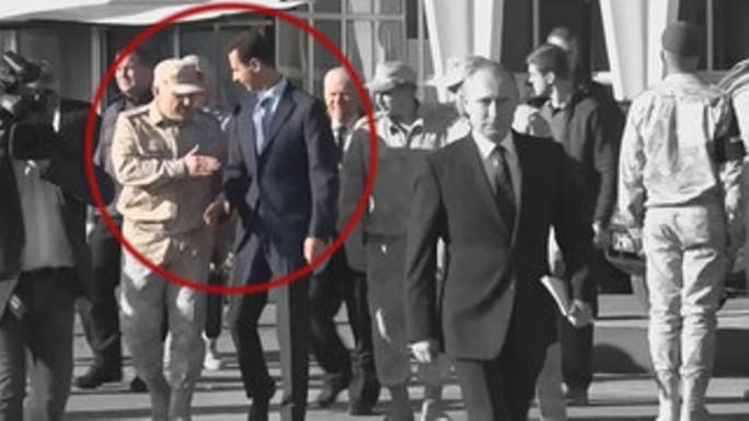 Binh sĩ Nga chặn tổng thống Syria lại gần ông Putin - Ảnh 1.