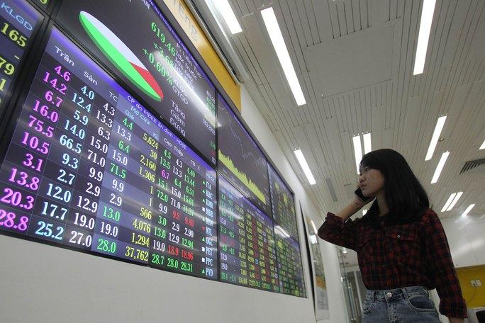 Giao dịch trên thị trường chứng khoán tăng mạnh trong 2 tuần quaẢnh: HOÀNG TRIỂU