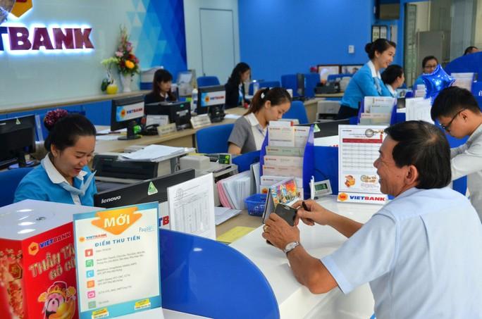 Kỳ vọng từ giảm sở hữu chéo ngân hàng - Ảnh 1.