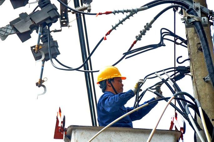 Ngành điện đang chịu nhiều áp lực tăng giá do các yếu tố đầu vào tăng Ảnh: TẤN THẠNH