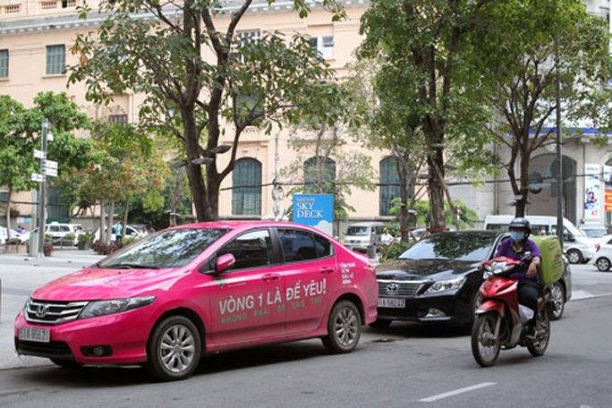 Bộ Tài chính lại giải thích về thuế đối với Grab, Uber - Ảnh 1.
