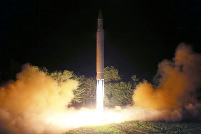 Mỹ dọa, Trung Quốc phản pháo - Ảnh 1.