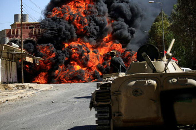 IS bị đánh bật khỏi những mảnh đất cuối cùng - Ảnh 1.