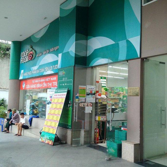 Báo Người Lao Động phát hành tại hệ thống Co.op Food - Ảnh 2.