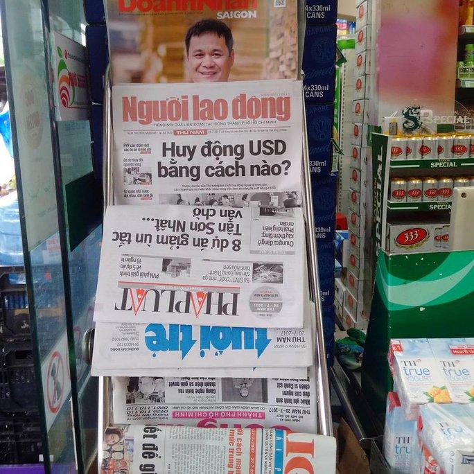 Báo Người Lao Động phát hành tại hệ thống Co.op Food - Ảnh 1.