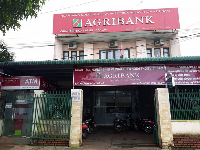 Dùng súng cướp ngân hàng táo tợn ở Đắk Lắk - Ảnh 1.