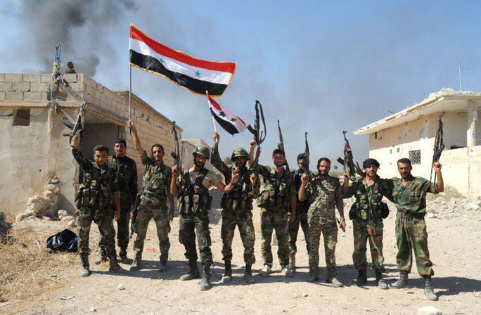 Syria tuyên bố toàn thắng IS - Ảnh 1.