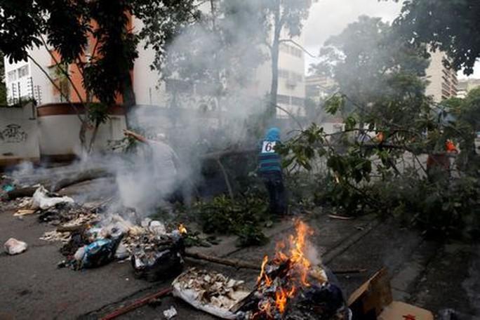 Venezuela: Đụng độ tại đình công triệu người, 3 người chết - Ảnh 4.