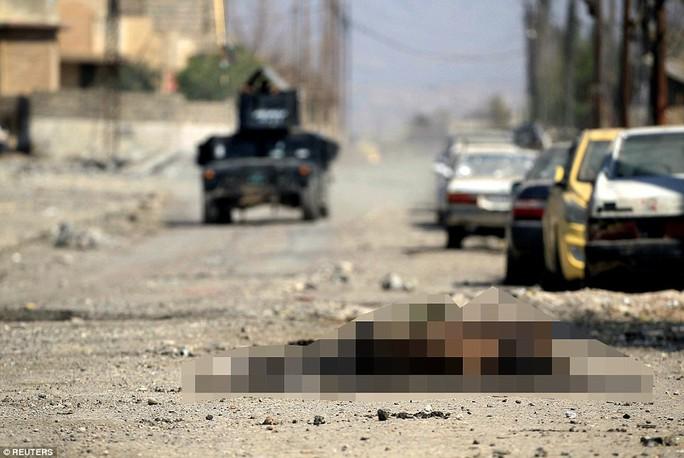 IS đang có dấu hiệu suy hiếu dần. Trong ảnh là xác của một tay súng IS tại Syria. Ảnh: Reuters