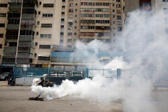 Venezuela: Đụng độ tại đình công triệu người, 3 người chết - Ảnh 3.