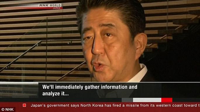 Triều Tiên phóng tên lửa bay qua Nhật Bản - Ảnh 4.