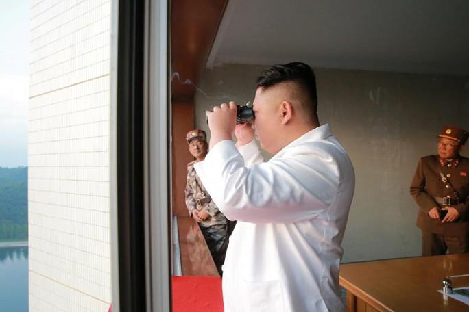 Mỹ: Trung Quốc đi cửa sau để ngăn chặn Triều Tiên - Ảnh 1.