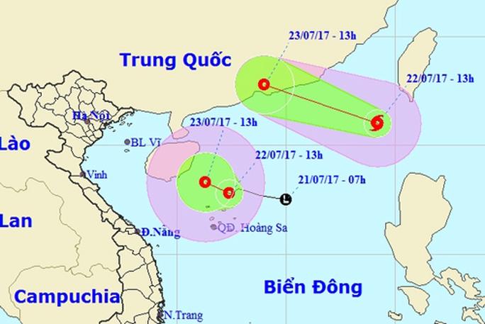 Hi hữu bão xuất hiện cùng áp thấp nhiệt đới trên Biển Đông - Ảnh 1.
