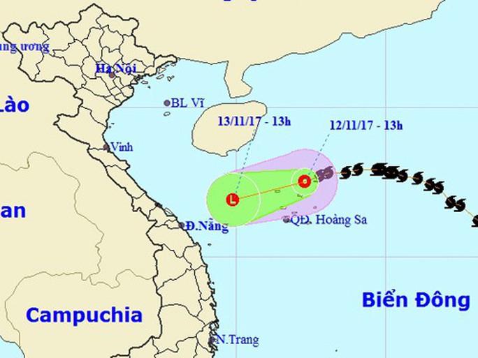 Bão số 13 bất ngờ suy yếu, có thể tan trên biển - Ảnh 1.