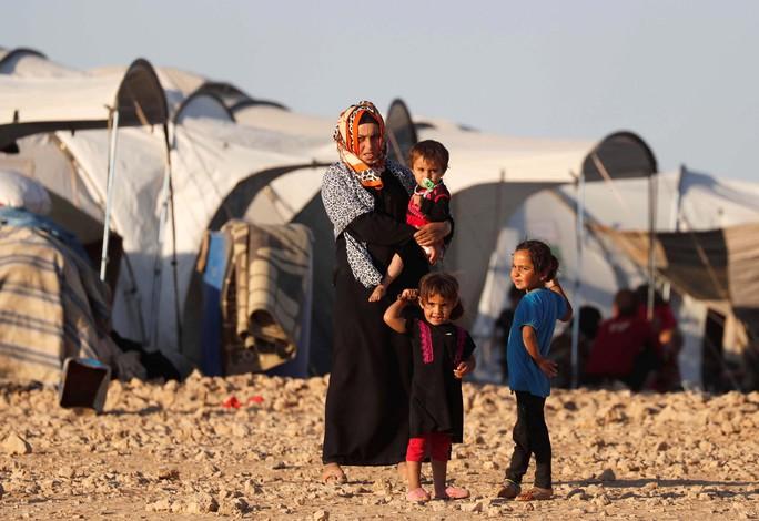 Những đứa con IS bị ruồng bỏ - Ảnh 1.