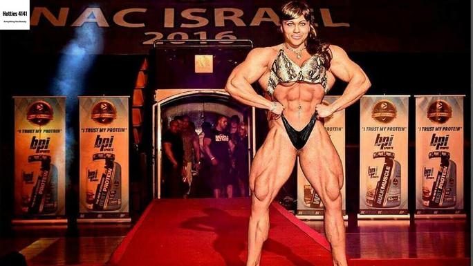 Choáng với cơ bắp của nữ lực sĩ nặng 90 kg - Ảnh 6.