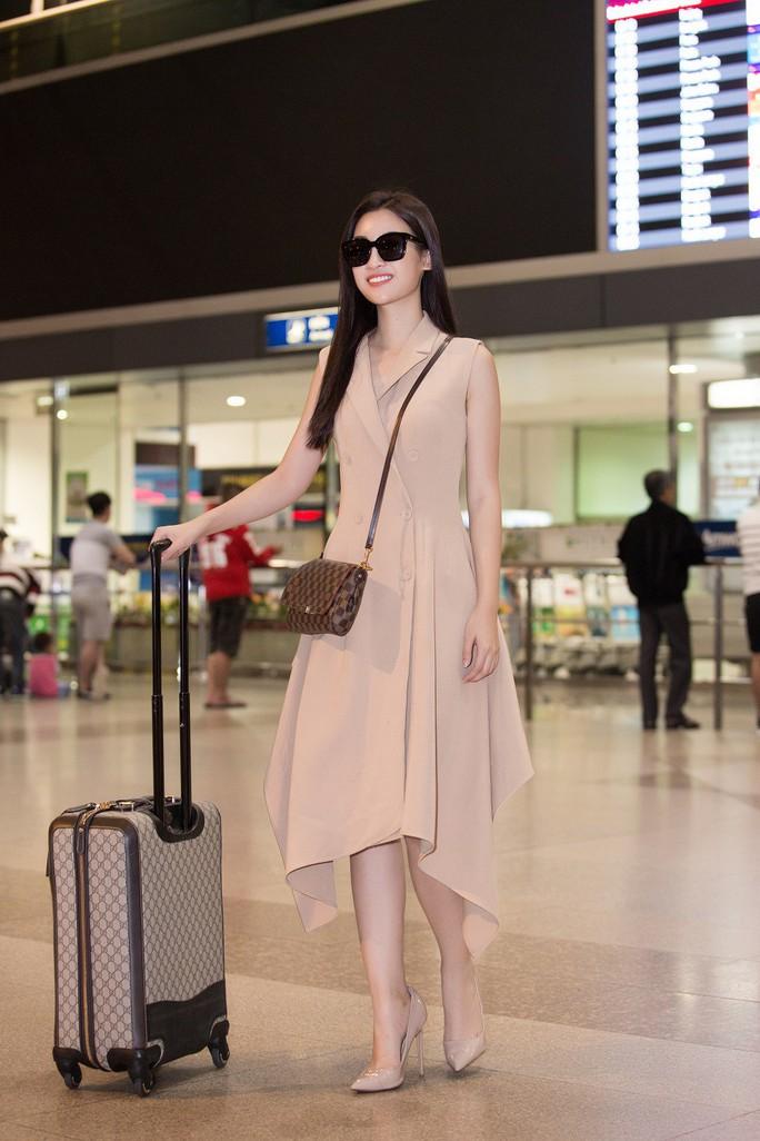 Hoa hậu Đỗ Mỹ Linh rạng rỡ ngày trở về - Ảnh 2.