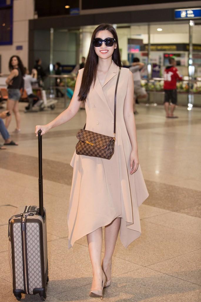Hoa hậu Đỗ Mỹ Linh rạng rỡ ngày trở về - Ảnh 3.