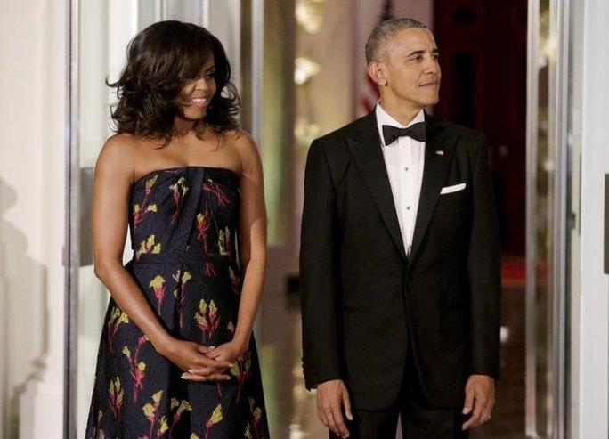 Ông Obama mặc một bộ vest suốt 8 năm - Ảnh 1.
