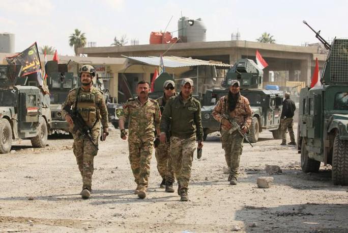 Lực lượng phản ứng nhanh Iraq ở khu vực Bab al-Tob, Mosul - Iraq hôm 14-3. Ảnh: Reuters
