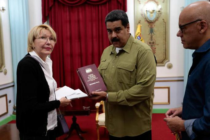 Tổng thống Maduro và bà Diaz. Ảnh: Reuters